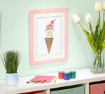 DIY Puffy Paint Ice Cream Craft in frame hanging on wall